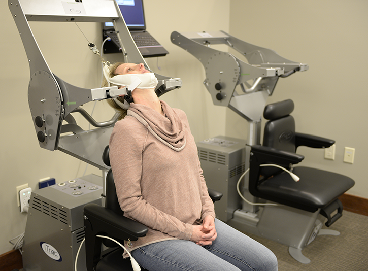 This photo shows a woman using the iTrac Spine Remodeling System.